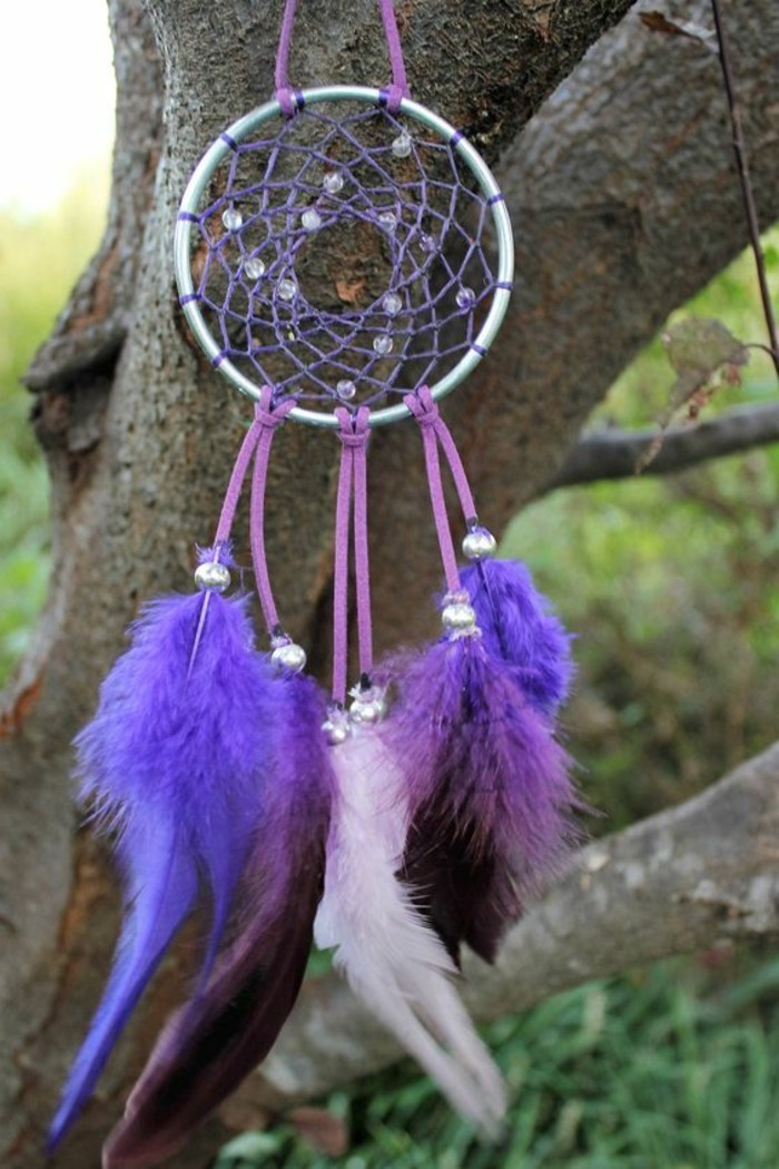 purple and violet, and pale pink feathers, attached to a small hoop, with purple woven net, and pale beads, diy dreamcatcher