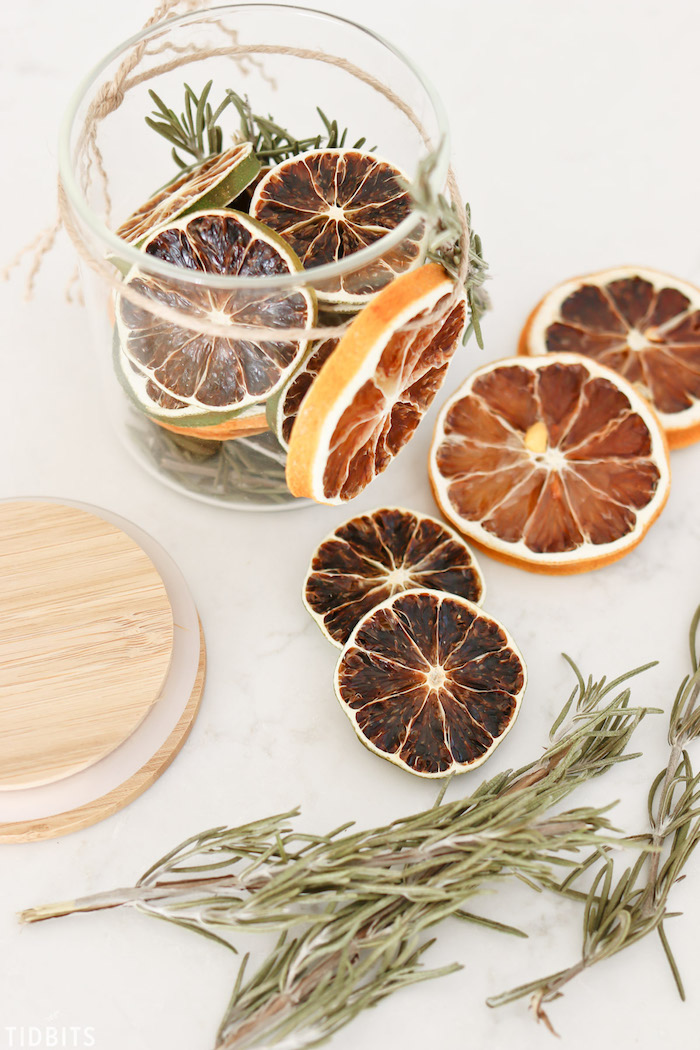 potpourri made in a glass jar, diy christmas gifts, dried lime and lemon slices, rosemary branches inside the jar