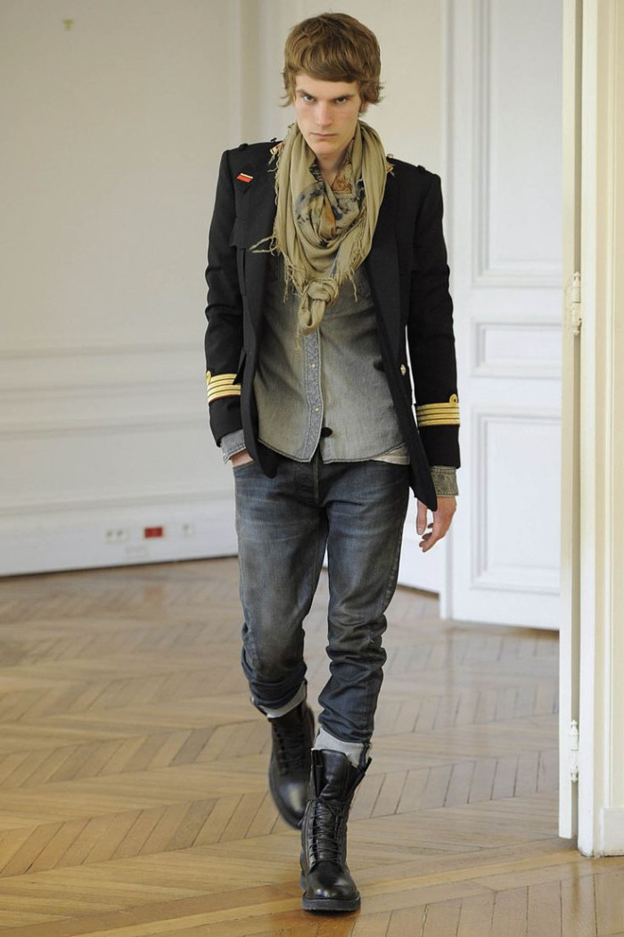 punk aesthetic 90s clothes mens, drummer military jacket, grey rolled-up jeans, lace-up combat boots, shirt and a scarf