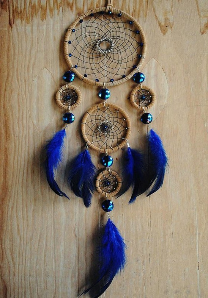 soft and fluffy, electric blue feathers, attached to a dreamcatcher, with five nets, and shiny turquoise beads