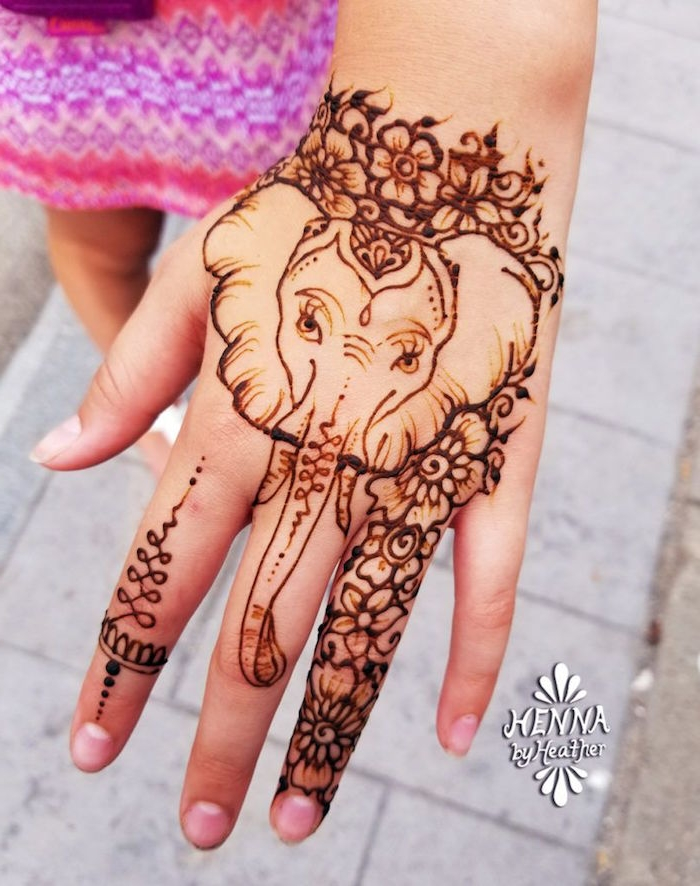 a9daebdc1 child's hand decorated with a drawing of an elephant, surrounded by  flowers, all done Mehndi ...