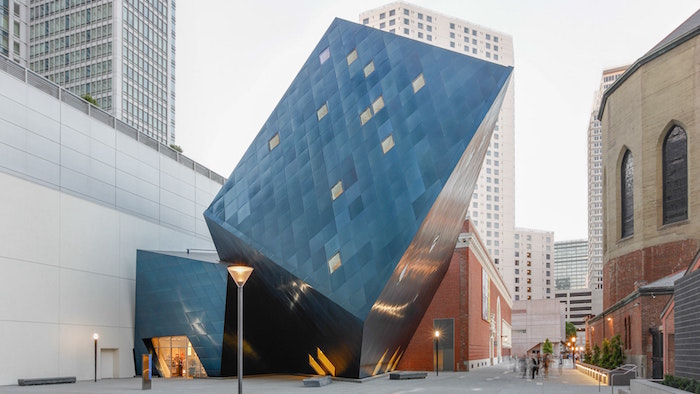 tilted cube-like structure, made of dark reflective glass, postmodern architecture, contemporary jewish museum, san francisco usa