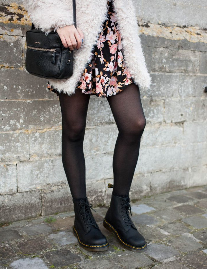 off-white fox fur coat, worn over a black mini dress, with pink floral pattern, 90s outfit ideas come out sheer black tights, and black combat boots