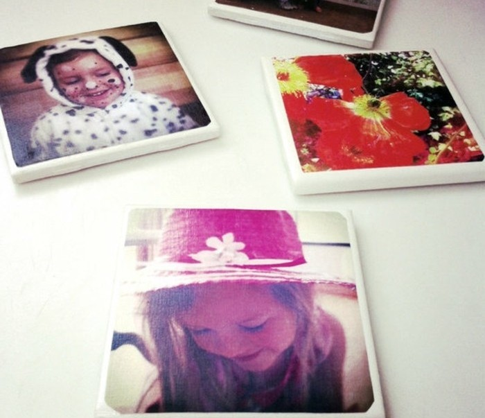 coasters made from thick white material, decorated with colorful family photos, handmade gifts, on a white surface