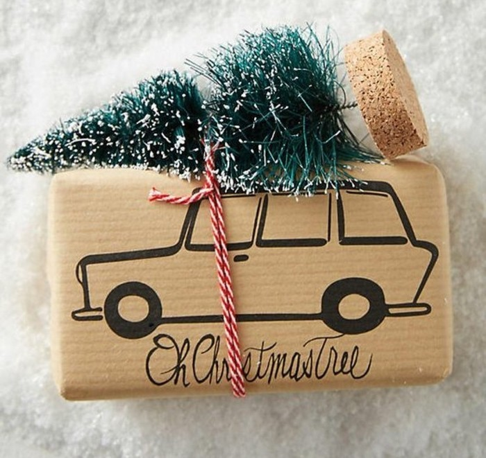 christmas tree ornament, tied with a white and red string, to a present, wrapped in beige paper, with a drawing of a car, handmade gifts