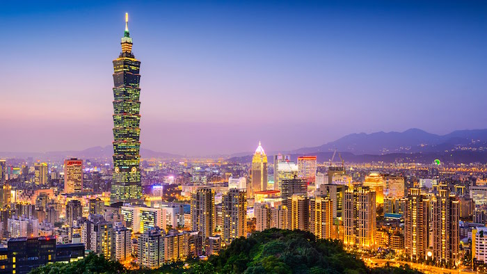 multicolored evening landscape, showing the city of taipei, postmodern design, a very tall skyscraper, taipei 101 to the left