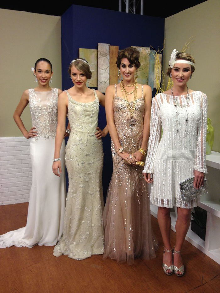 cream and white and nude pink, elaborately embroidered gatsby inspired dresses, on four smiling women, with 1920s hairstyles and accessories