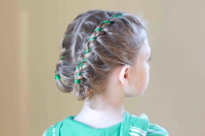 hoodie in green, with white stripes, worn by a child, with dark blonde braided hair, little girl hairstyles, decorated with green ribbons