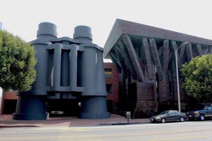 building shaped like a pair of giant binoculars, in dark grey, postmodern architecture in Los Angeles
