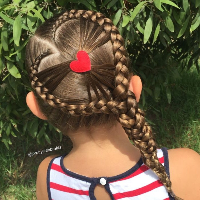 decoration shaped like a heart, on a small brunette girl's head, surrounded by two braids, forming a large heart-shape