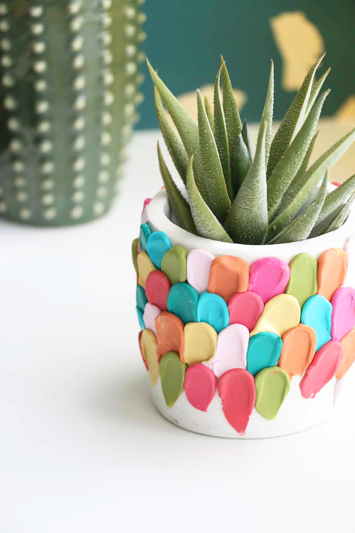 white ceramic pot, decorated with parts of colorful clay around it, best friend gifts diy, succulent growing inside