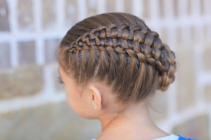 cute hairstyles, close up of a complex braided up-do, on the head of a brunette child, seen from the back