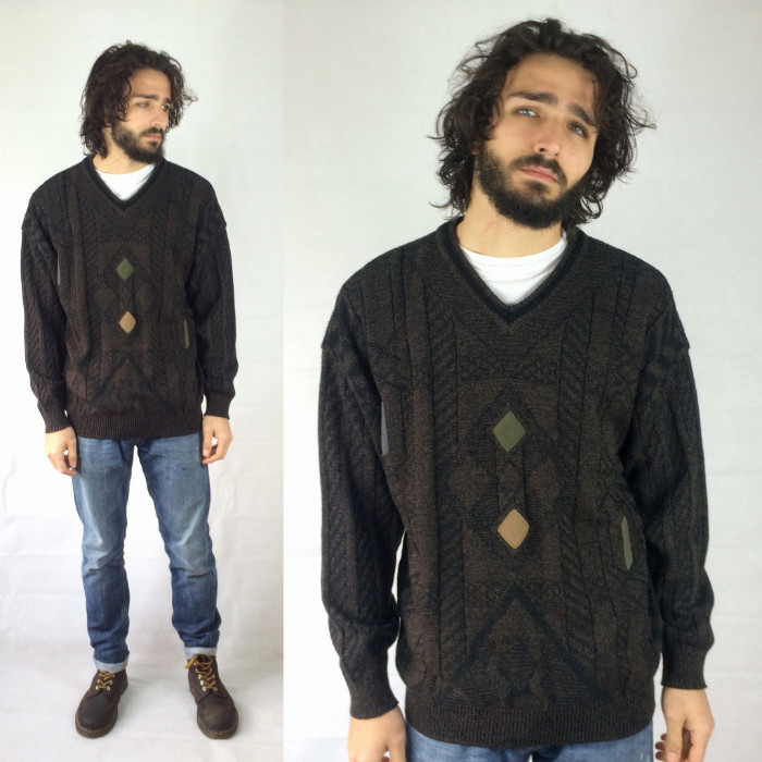 v-neck oversized knitted sweater, with beige and green details, 90s party outfits for guys, worn by curly brunette man, with jeans and worker's boots