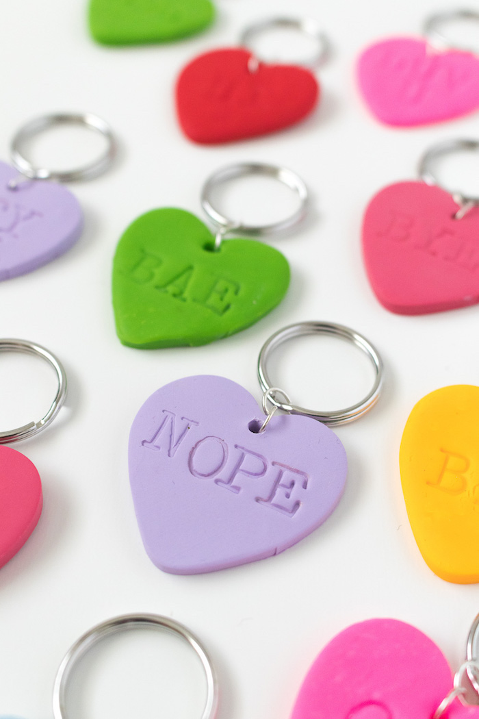 heart shaped keychains, made of fimo leather, best friend gifts diy, personalised wording on them, white background