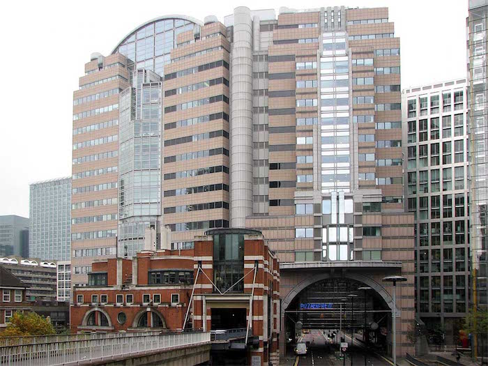 angular and round elements, incorporated in a large building, with lots of glass segments, postmodern buildings in london