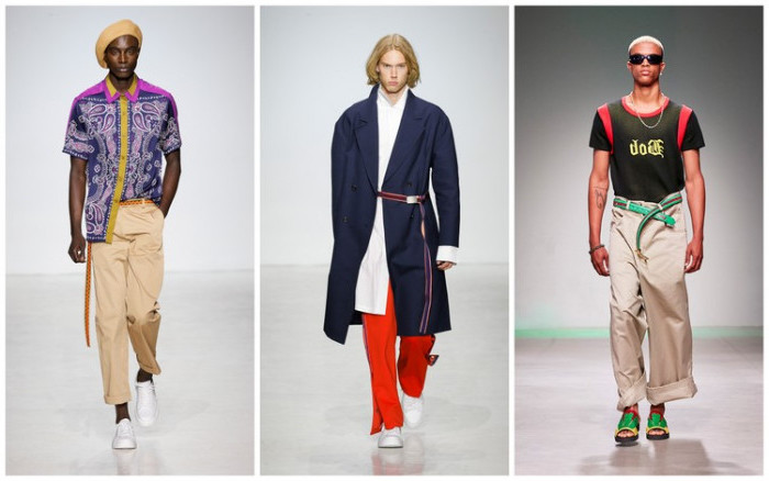 colorful 90s party outfits for guys, three male models on a catwalk, beige trousers and a purple shirt, oversized navy coat and red trousers, olive green and red tee