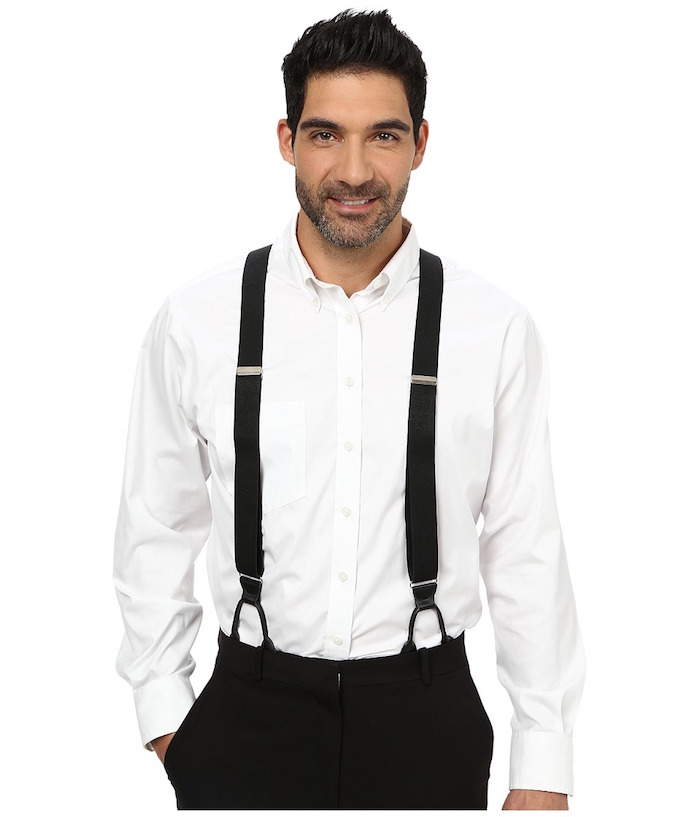 20s mens fashion, suspenders in black, a white shirt, and black trousers, worn by a smiling man, with stubble on his face, and one hand in his pocket