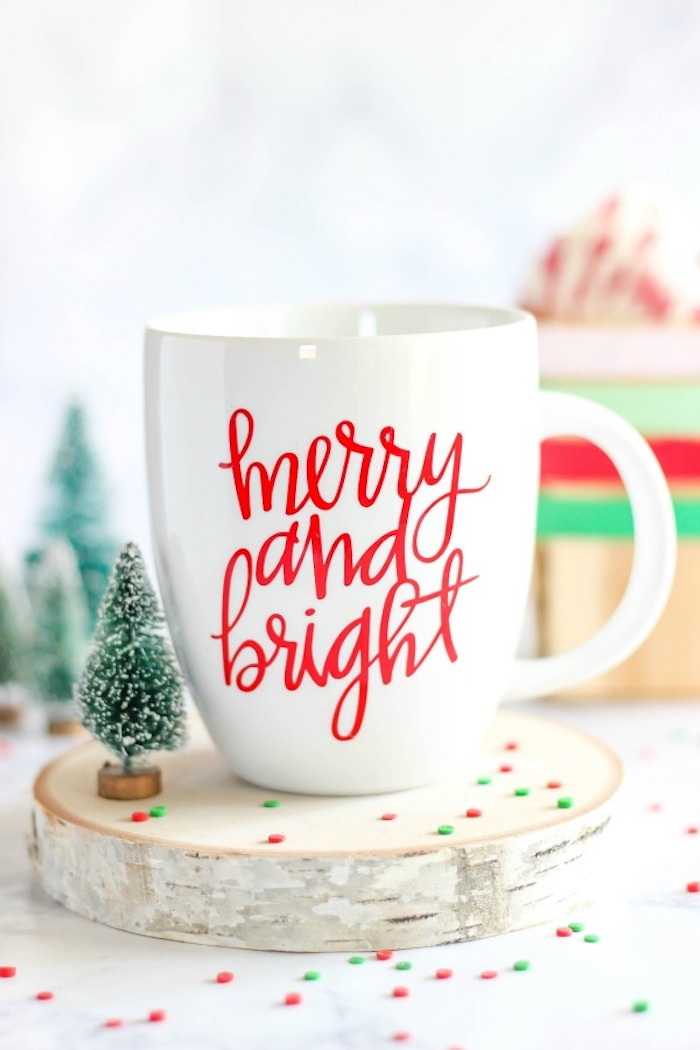 creative gift ideas, merry and bright christmas coffee mug, placed on wooden log, small faux toy tree next to it