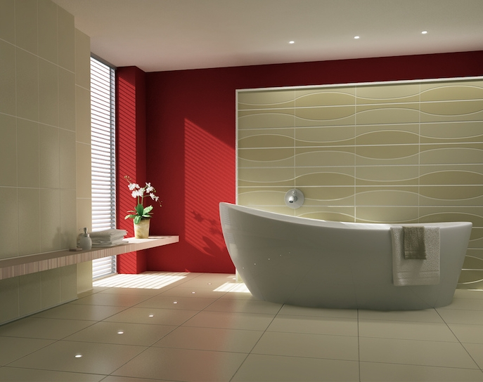 modern bathroom ideas, red and cream walls, in a sunlit room, containing a modern oval white bathtub, a potted plant and folded towels, and an off-white tiled floor