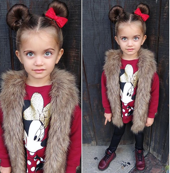 faux fur vest, worn over a red sweater, with a minnie mouse print, and black leggings, by a child with two buns, on each side of her head, little girl hairstyles, red bow decorating one of the buns