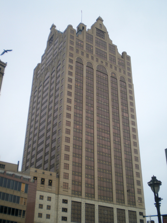 tower-like skyscraper, in different shades of brown, decorated with arches, and elements inspired from classic architecture, postmodern buildings in wisconsin