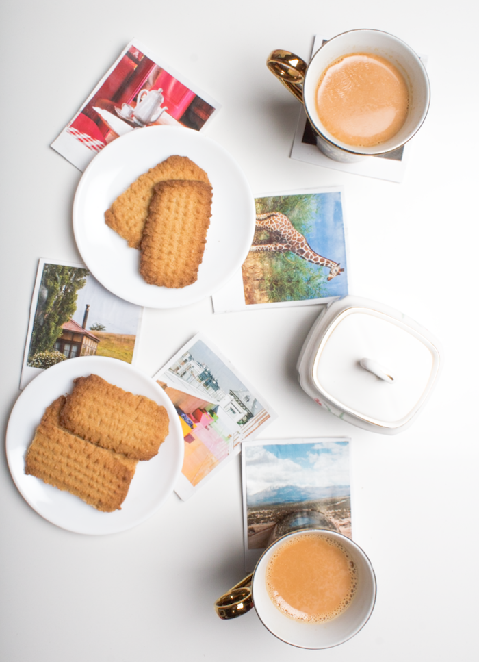 photos of nature and animals, placed on a white surface, white plates with cookies and coffee mugs, best friend gifts diy