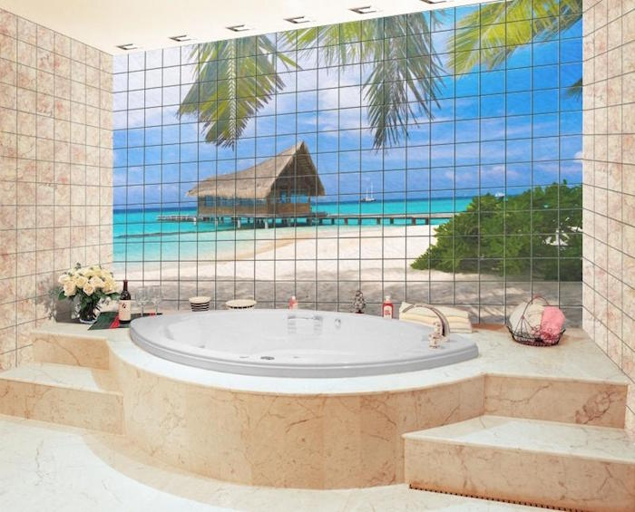 exotic beach landscape, with palm trees, and a straw hut, on a tiled wall, inside a bathroom with a round tub