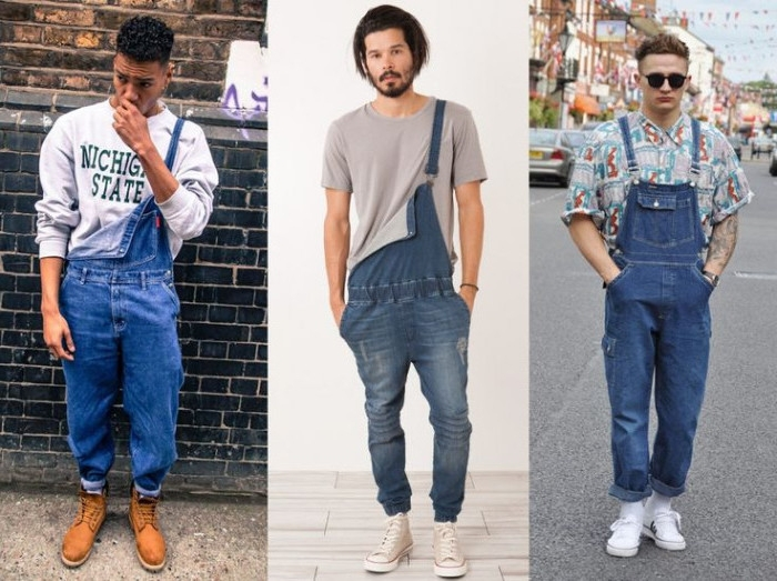 faded partially unbuttoned overalls, with elasticated wist, retro denim 90s overalls, worn with a plain t-shirt, a large jumper, and a patterned shirt