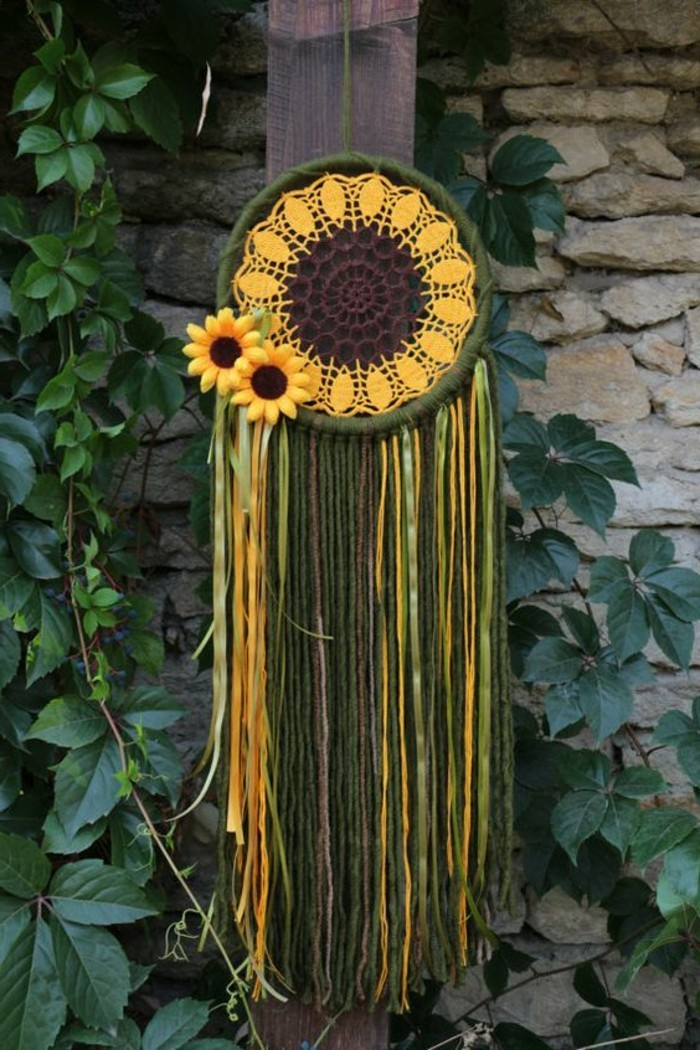green and yellow dreamcatcher, with a crocheted doily, painted in yellow and brown, like a sunflower, green and yellow tassels