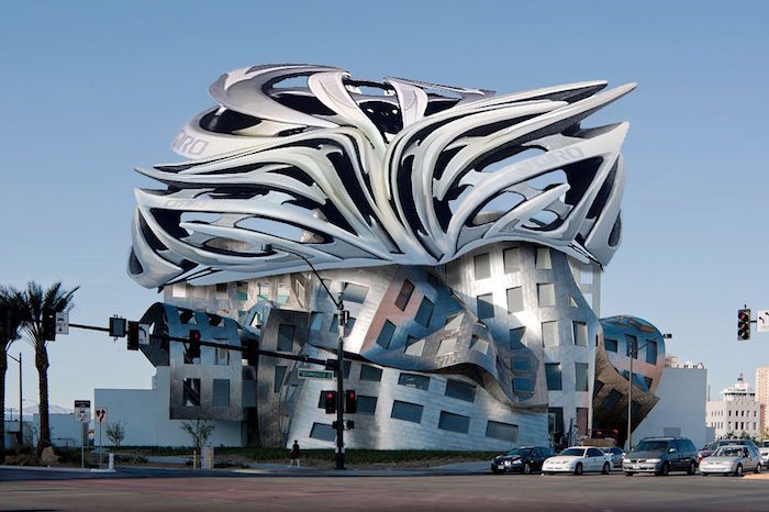 postmodern design, abstract metal-look building, with a molten-effect roof, and a bottom part that looks twisted or folded, vertical and horizontal windows