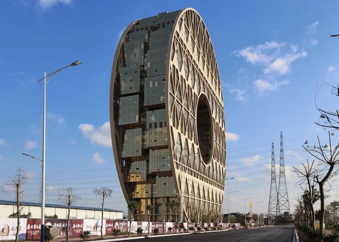 donut-shaped building, with lots of glass segments, postmodern design, built near an empty street, lined with trees