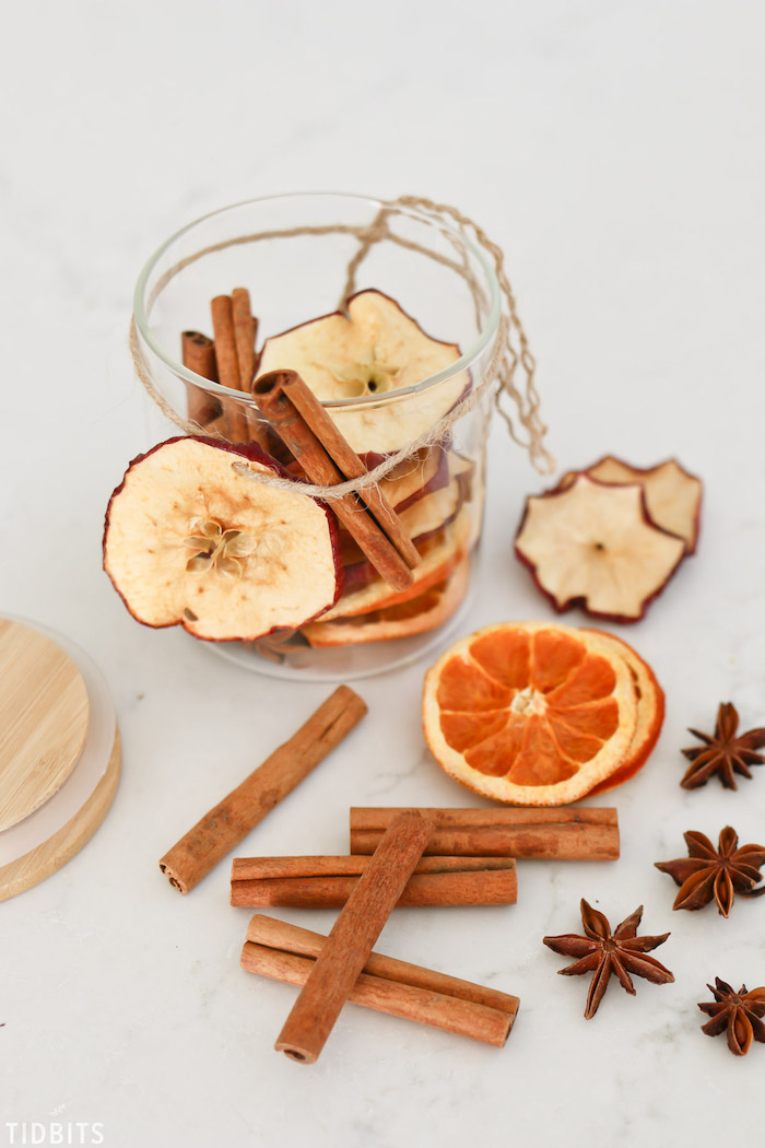 dried apple and orange slices, cinnamon sticks inside a glass jar, diy christmas gifts, potpourri made in a glass jar