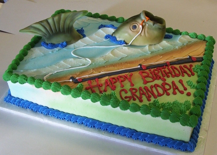 fish attached to a fishing pole, decorating a rectangular birthday cake, in pale blue green and orange, 60th birthday ideas, happy birthday grandpa, written in red frosting