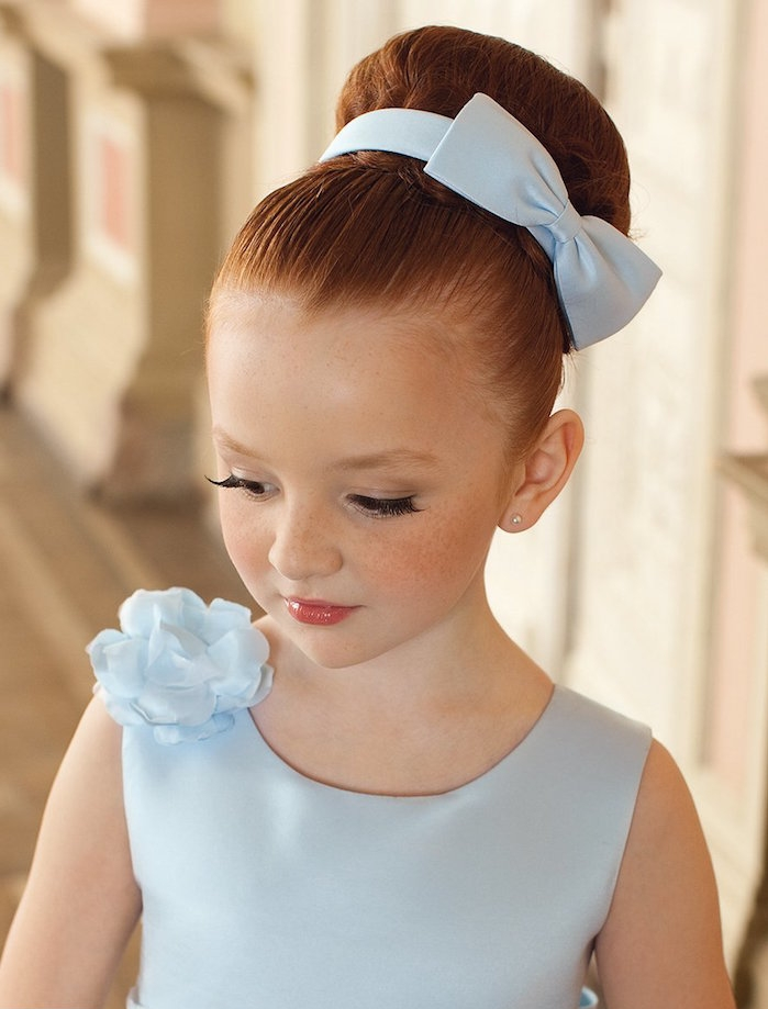 smooth large bun, decorated with a pale blue bow, hairstyles for little girls, red-haired child, in a pale blue formal dress