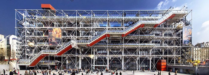 external staircase in red and white, attached to a large rectangular building, with a scaffolding-like structure, postmodernism characteristics, surrounded by lots of people