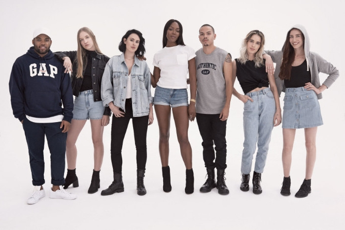 female and male models, posing in 90s style clothes, retro baggy jeans, denim shorts and jackets, t-shirts and hoodies