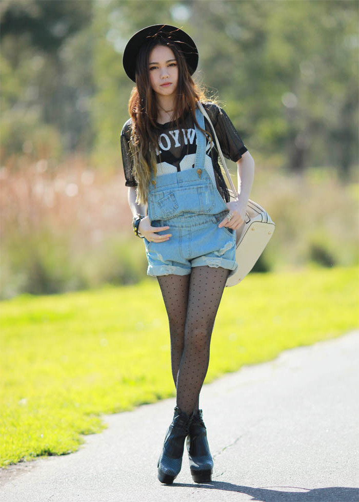 polka dots on sheer black tights, worn with a sports t-shirt, and short baggy denim overalls