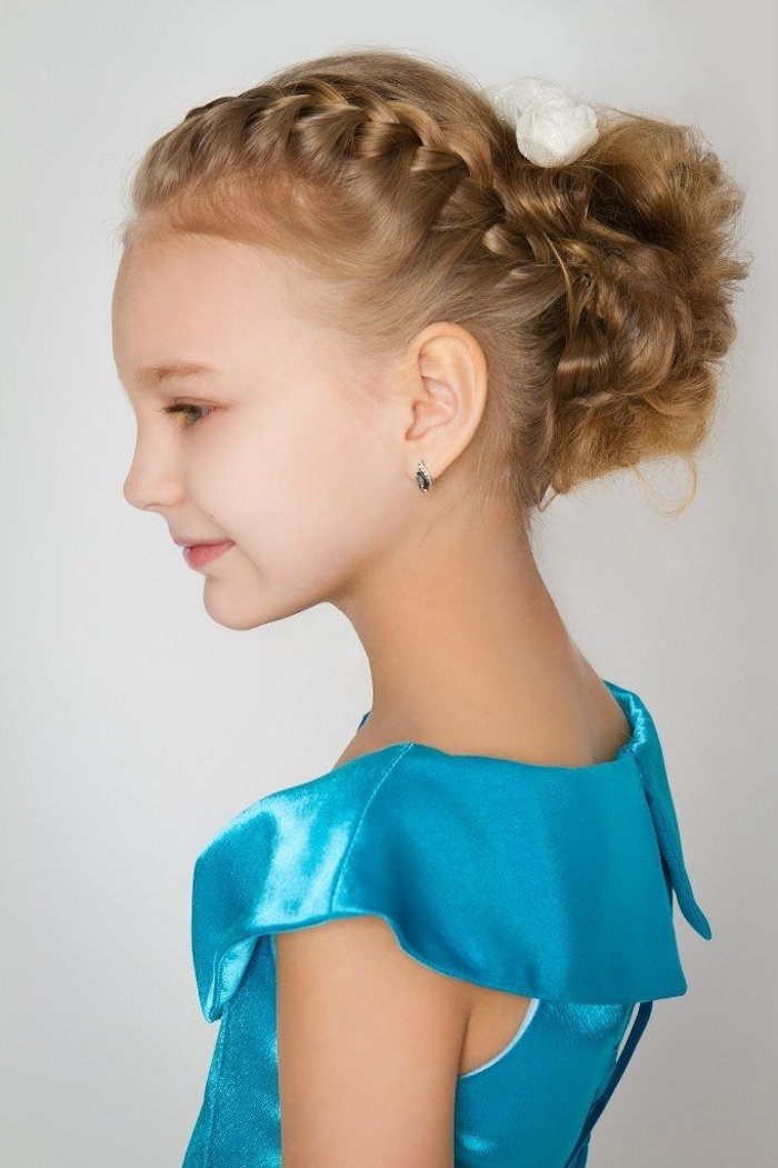 pale young girl, in a smart, shiny teal dress, with dark blonde hair, woven into a side-braid, little girl haircuts, a messy curled bun at the back