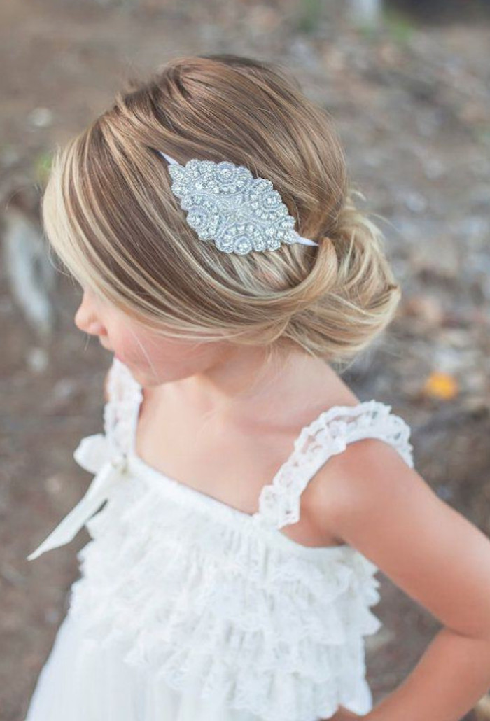 simple hairstyles, silver hair ornament, with diamante details, decorating the smooth, dark blonde hair, of a small child, white frilly lace top, natural highlights