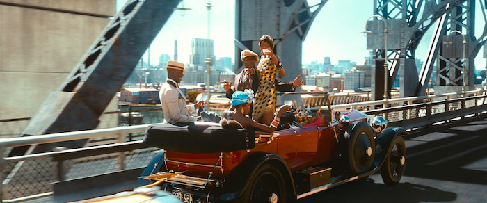 red antique car, speeding on a bridge, inside are a group of black youths, drinking champagne and partying, dressed in roaring 20s fashion