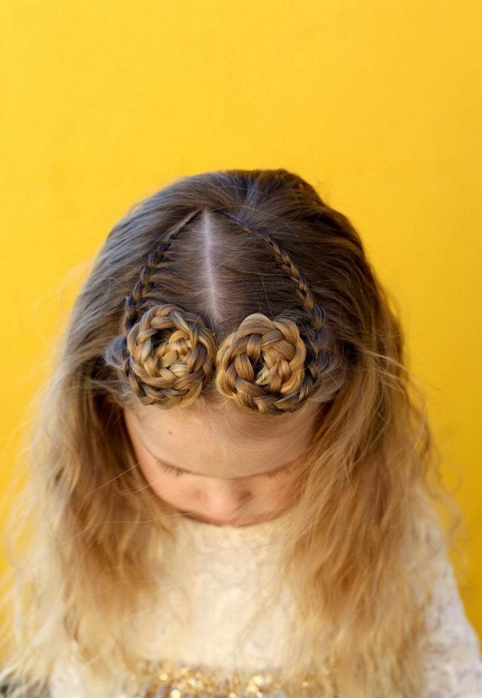 round braided swirls, on the top of a small child's head, little girl hairstyles, seen from a high angle