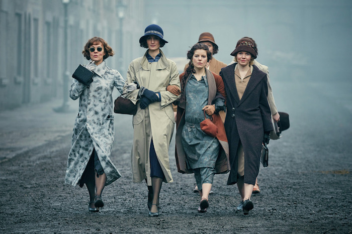 female characters from bbc's peaky blinders, wearing flapper-style attire, low-waisted dressed and wrap coats, roaring 20s dress ideas for parties