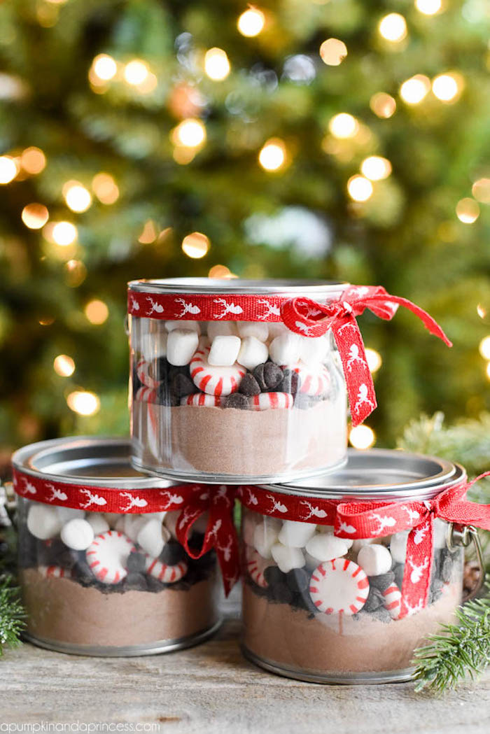 deconstructed hot chocolate inside small jars, thoughtful christmas gifts, decorated with red ribbon around the lid