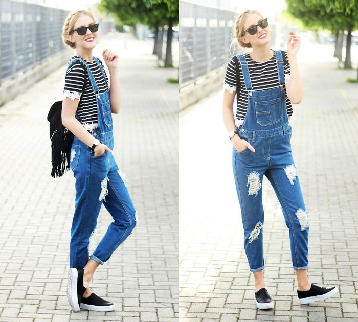 90s overalls, smiling blonde woman, with a crown braid, wearing a striped t-shirt, with lace details, under long ripped denim overalls