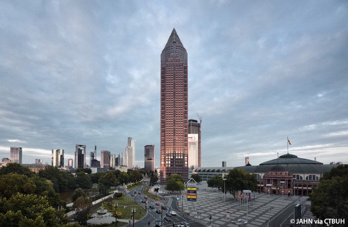 pencil-shaped brown tower-like skyscraper, in the middle of a city square, messeturm in frankfurt