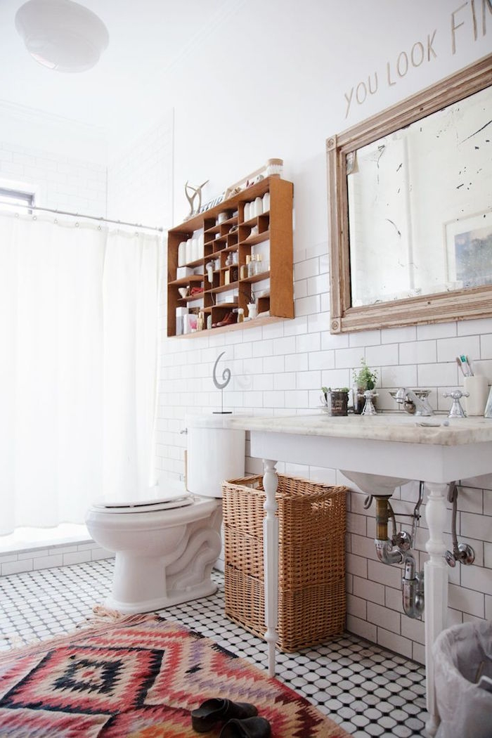 rug with an aztec red and black pattern, diy bathroom décor, in a bright room, containing a shower area, with a white curtain, a marble sink, a toilet bowl, and a large mirror