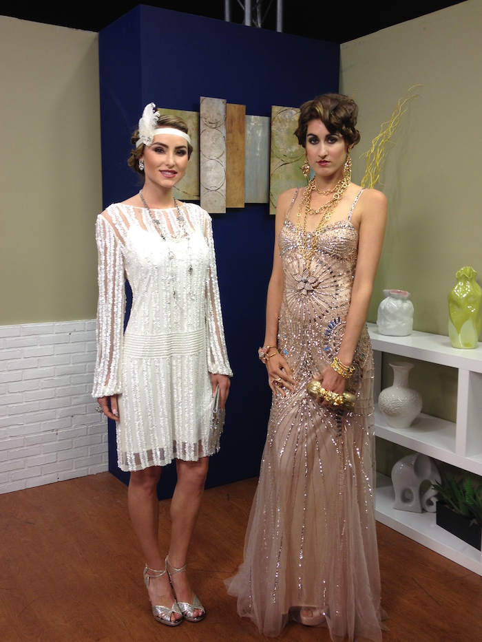 beads and silver embroidery, on a nude pink maxi dress, worn with lots of jewelry, by a brunette woman, standing next to a woman, in a white gatsby dress, with lace and embroidery