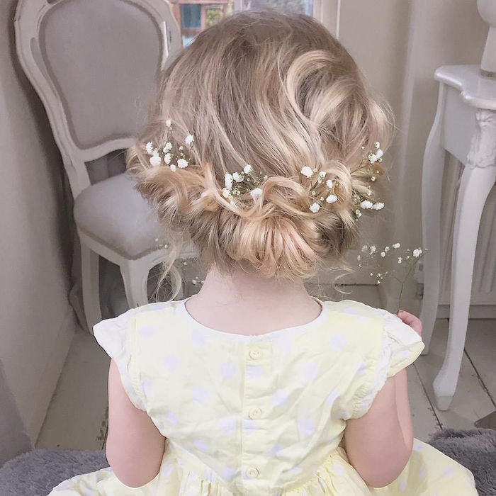 tiny white flowers, decorating the hair of a little girl, cute hairstyles, fancy wedding up-do for a flower girl, blonde hair with natural highlights