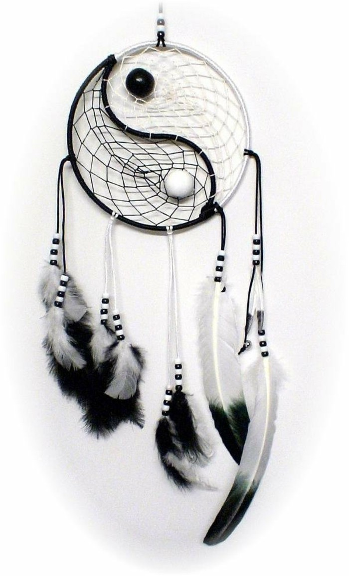 monochrome dream catcher, with white and black feathers, matching two-tone beads, and a yin and yang motif
