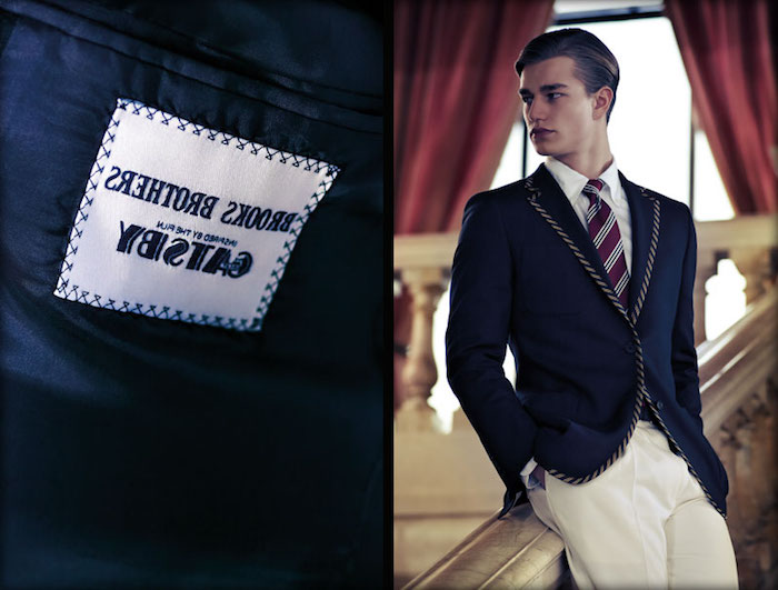 great gatsby costumes, young man wearing a navy blue blazer, with rope-like trims, over white trousers, and a white shirt with a striped tie, brooks brothers label